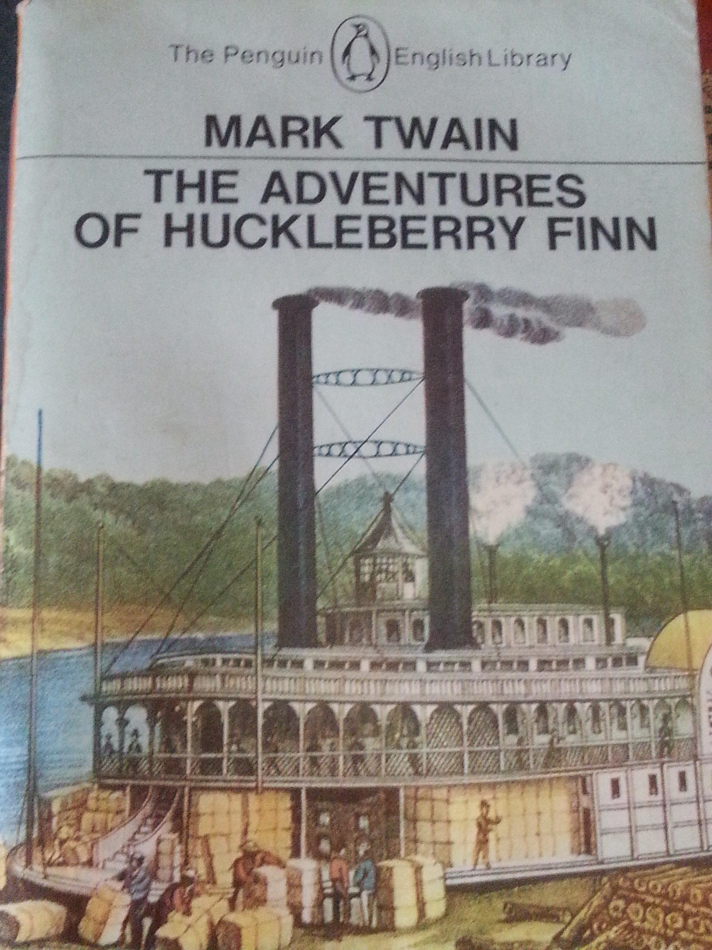 The Adventures of Huckleberry Finn by Mark Twain...