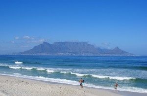 """Table Mountain DanieVDM"" by Danie van der Merwe from Cape Town, South Africa - View of Table Mountain from Bloubergstrand. Licensed under CC BY 2.0 via Wikimedia Commons - https://commons.wikimedia.org/wiki/File:Table_Mountain_DanieVDM.jpg#/media/File:Table_Mountain_DanieVDM.jpg"