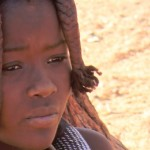 Young puberescent Himba girl...